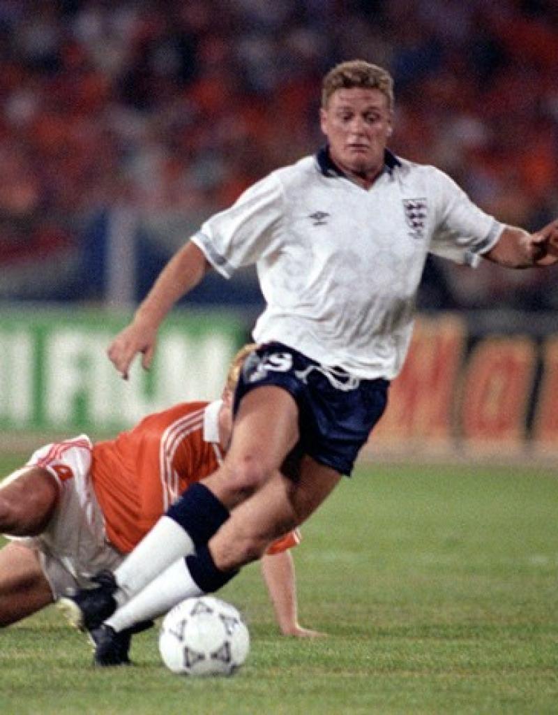 Soccer – FIFA World Cup Italia 90 – Group F – England v Netherlands – Stadio Sant'Elia, Cagliari.     England's Paul Gascoigne skips past Netherlands' Ronald KOEMAN
