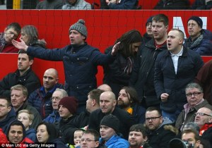 Fans react angrily at a recent Manchester United game at Old Trafford.
