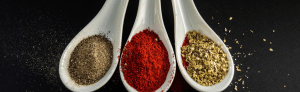 Three spoons displaying different seasonings and rubs, at Garcia Spices we create custom blends for all your cooking needs.