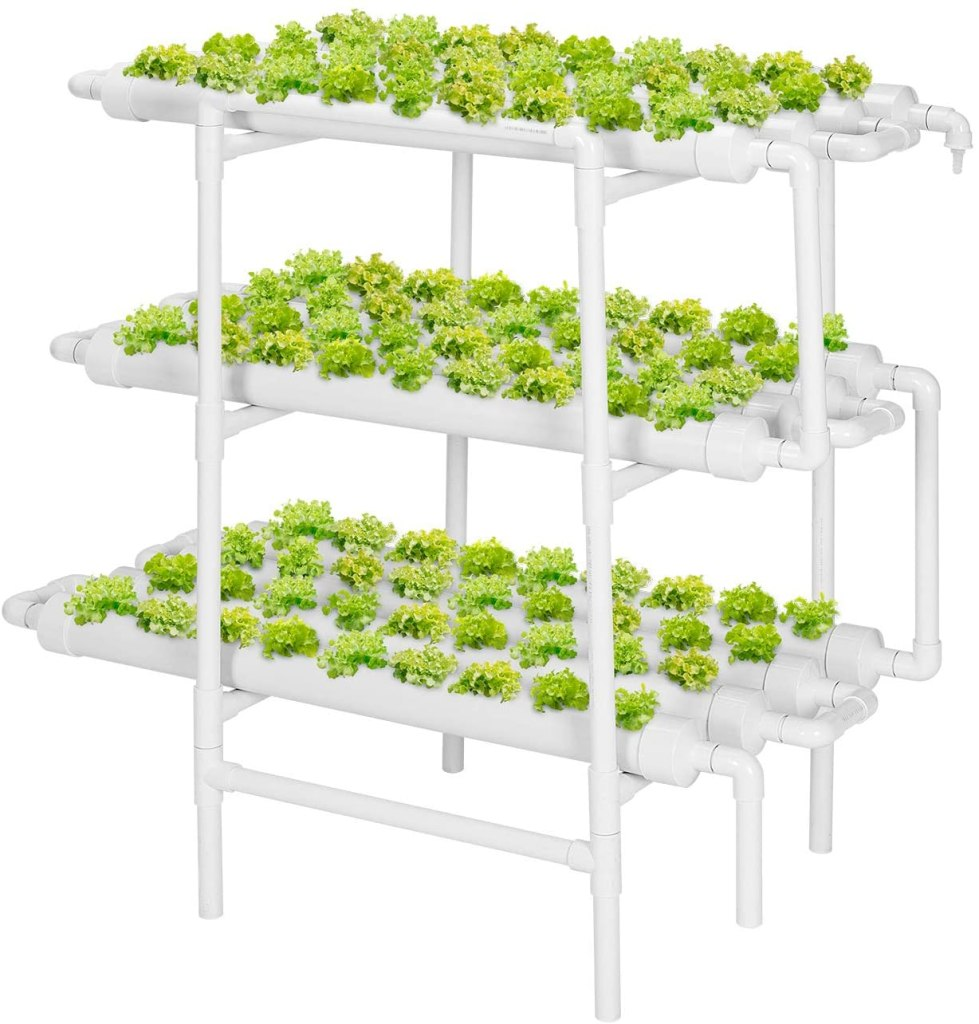 A ebb and flow hydroponic system made up of 12 white PVC pipes, and several white tubes, with crisp green lettuce growing in 108 grow sites.