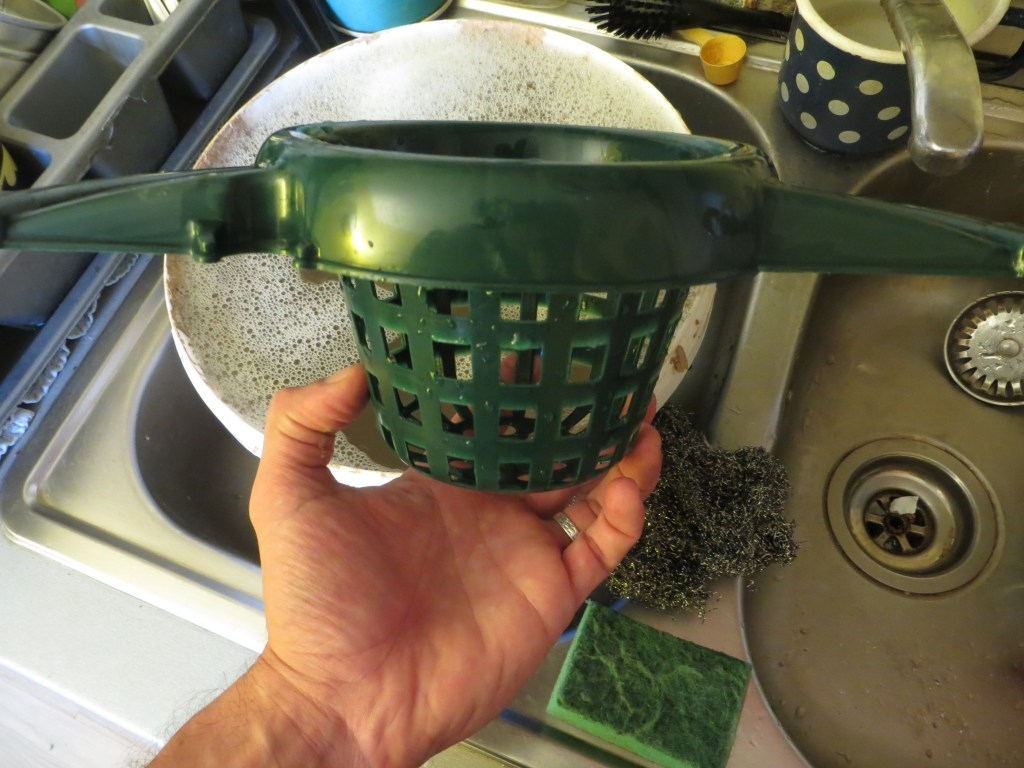 A green netted mop strainer.