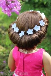 doll hairstyle headband tuck bun