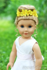 doll hairstyle bun with flower