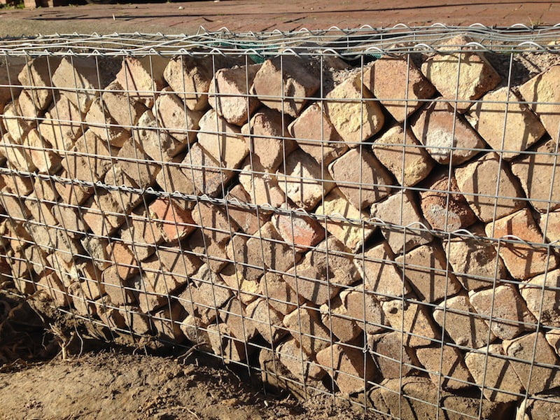 Gabion design ideas gardendrum for Uses for old bricks