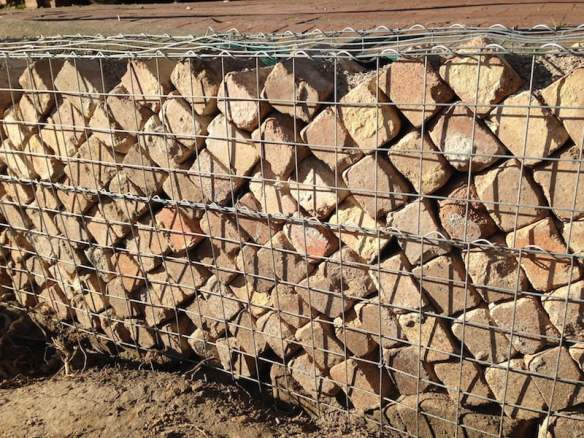 Old house bricks used as a gabion retaining wall filler. Photo Sandra Heggen