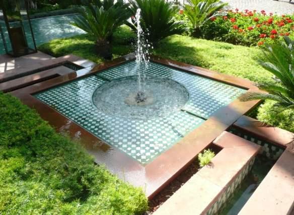 Hotel La Mamounia Pond and rill nestled into the garden