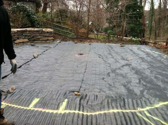 Marking out the labyrinth perimeter on the black landscape cloth