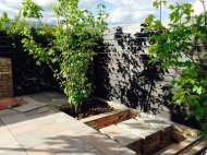 Day 10 on site - hard landscaping finished and the Acers go in (from Sid's blog)