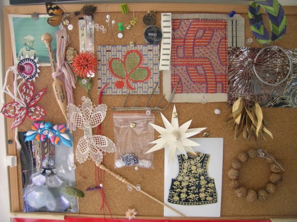 Pin board above Vicki's work bench with items of inspiration