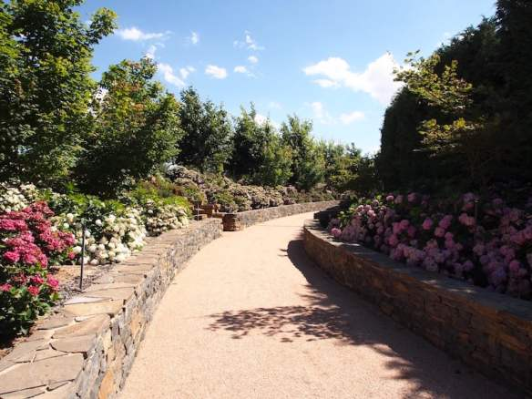 Well-built bluestone walls line the grand entry path