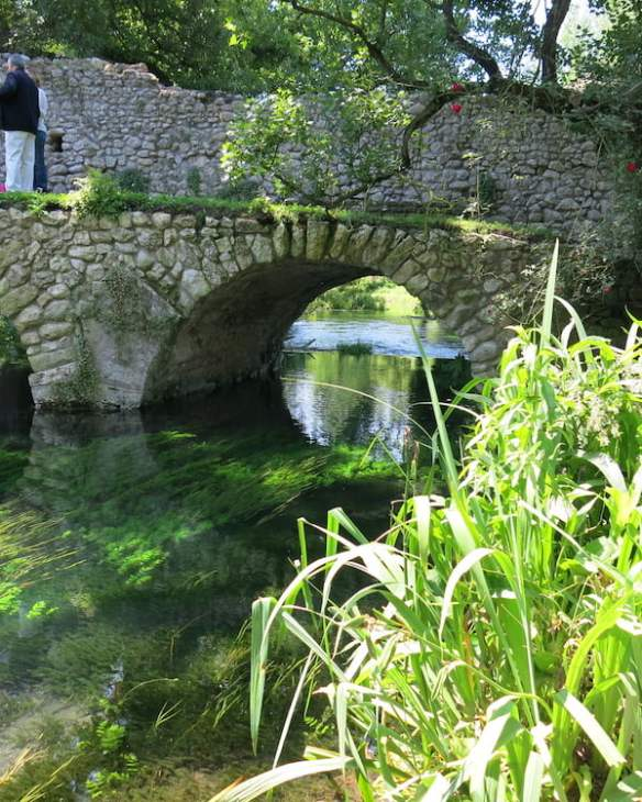 Bridge over crystal clear water at Ninfa. Photo Deryn Thorpe