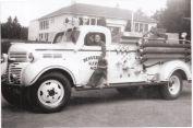 Jean Johnson and dog Billy Boy at Garden Home Garage. Truck is local Volunteer Beaverton Fire Department.