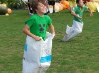 Joey in the sack races The Great Pumpkin Carnival