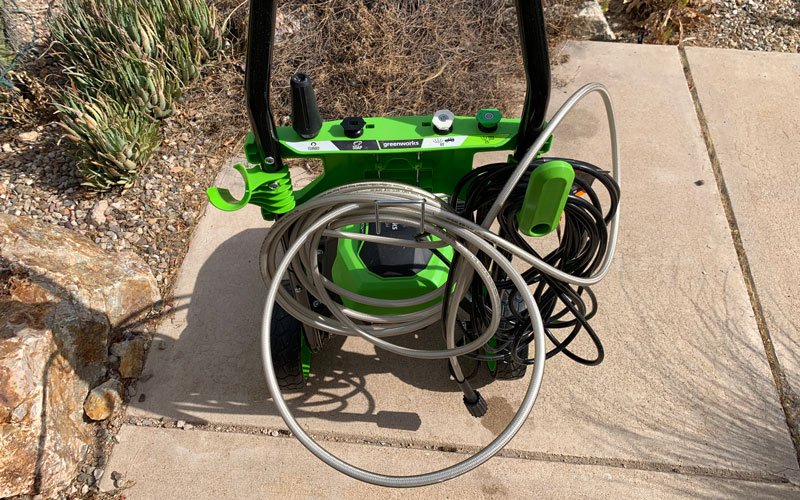 Greenworks-1800-PSI-Pressure-Washer-tangled-coil-on-machine