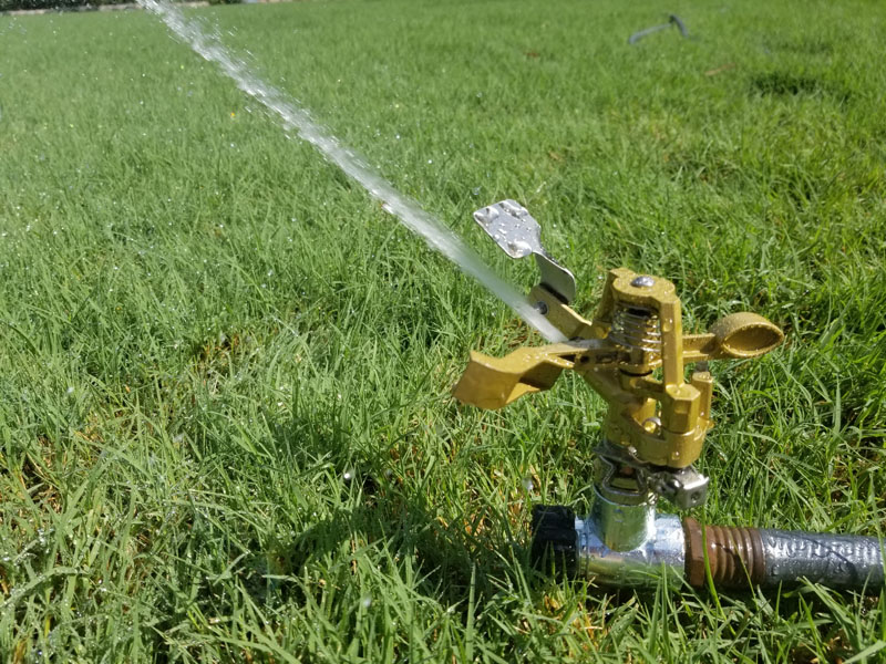 Melnor pulsating sprinkler in use