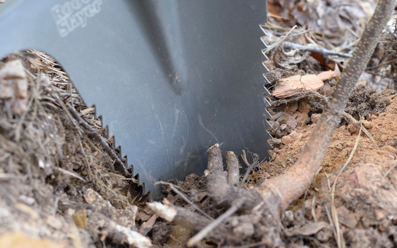 Radius Root Slayer Shovel cutting through fiberous roots