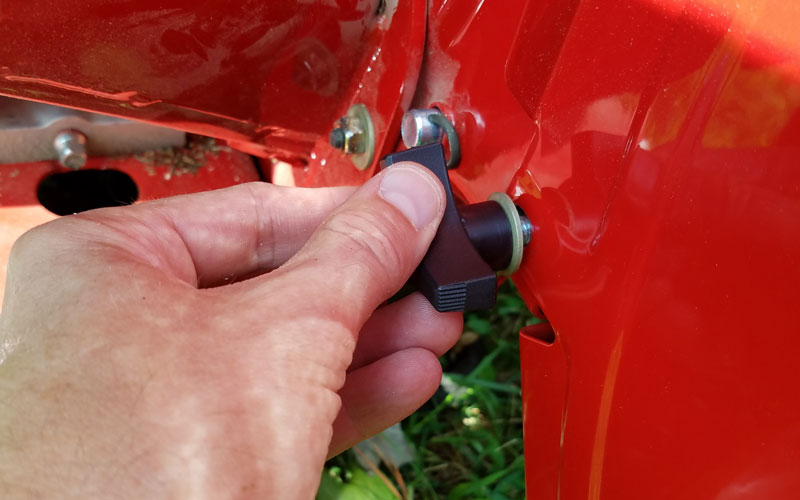 Troy-Bilt Chipper Shredder removing the discharge chute