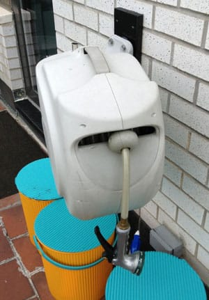Frontgate Retractable Hose Reel Mounted On Wall