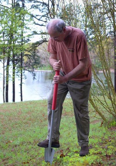 long-handled Root Assassin shovel in use