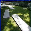 Rectangles of sheet metal laid on a lawn at interesting angles to serve as a walkway