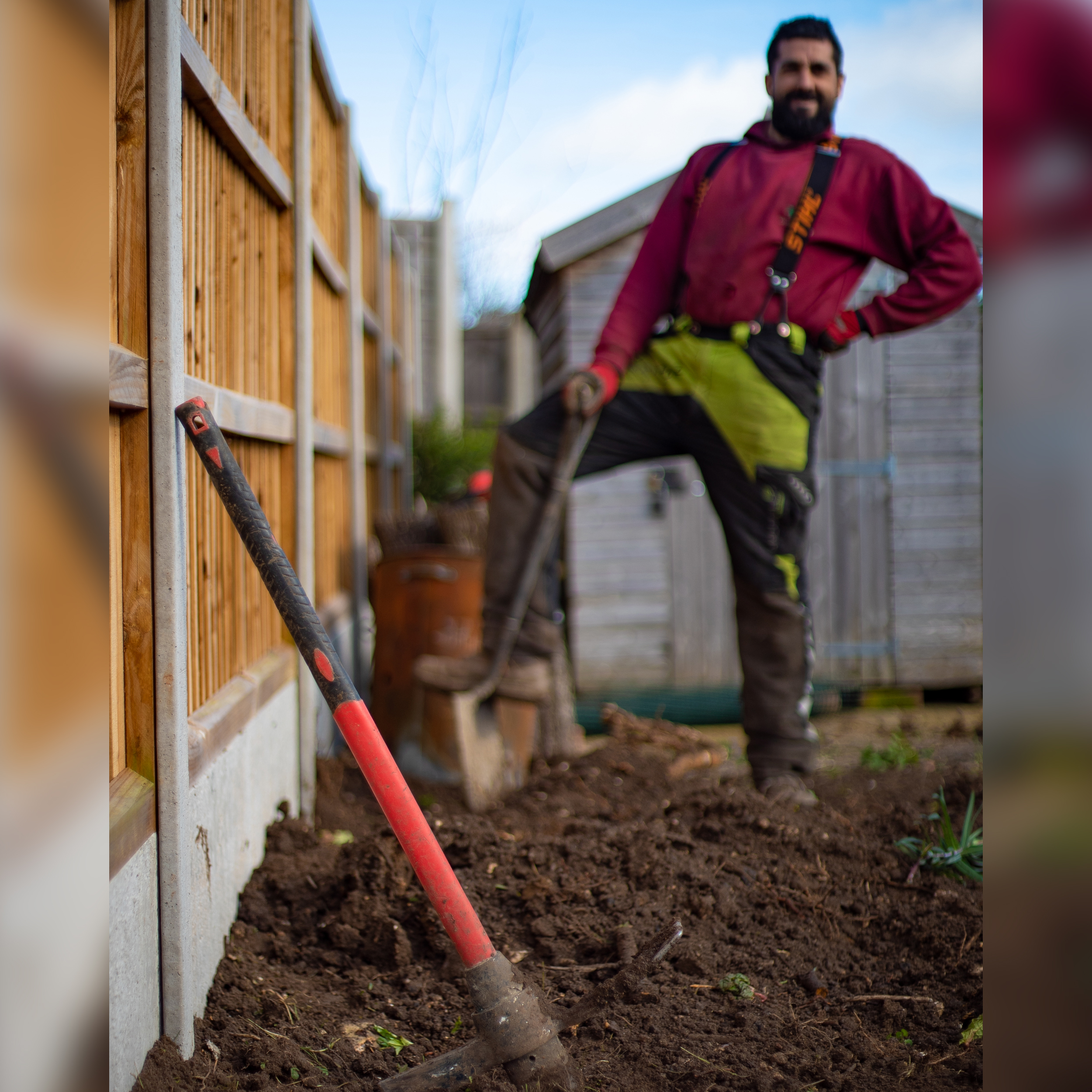 Garden Knight team member Nick posing with a spade on a fencing job