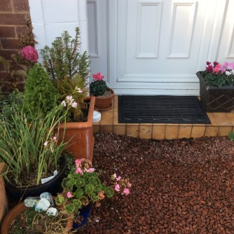 Potted plants dot the entrance