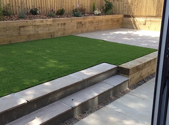 Artificial lawn in a low-maintenance Nab Wood garden