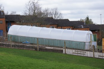Today, we finish the polytunnel. Just a couple of beds left to fill with compost!