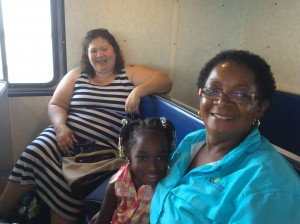 Mrs. Grovner, grandbaby, and friend on the ferry.