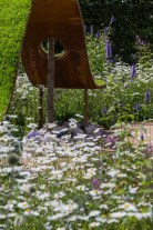 The World Vision Garden. Designed by: John Warland. Sponsored by: World Vision. RHS Hampton Court Palace Flower Show 2016.