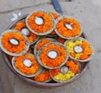 India, Varanasi. Marigold votive offerings