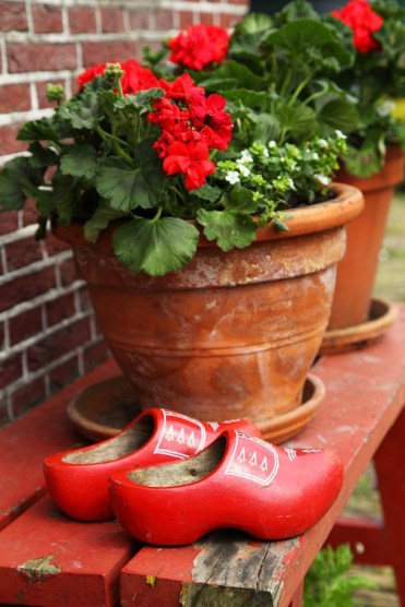Netherlands - red seat, flowers and clogs. Photo PublicDomainPictures