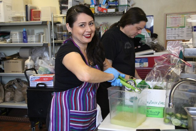 Claudia Serrato (P'urhepecha) juicing limes to cure the fish. Photo by Elizabeth Hoover