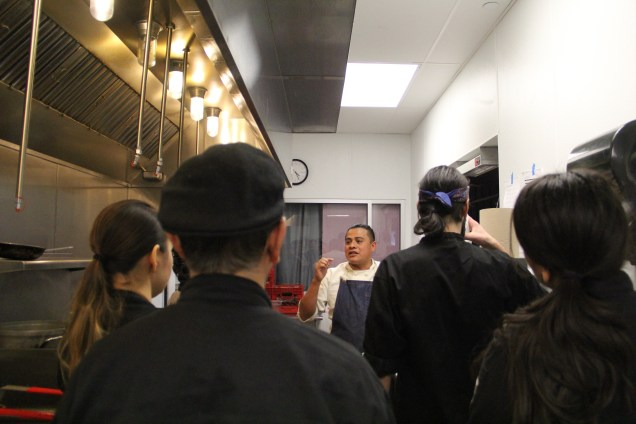 Kitchen crew meeting before the meal begins. Photo by Elizabeth Hoover
