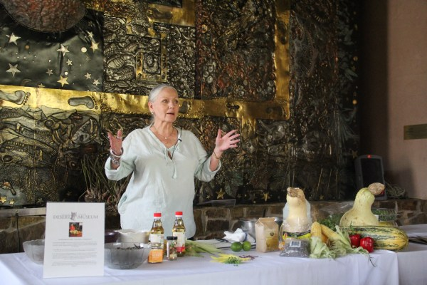 """Loretta, presenting about her career in Native foods; encouraging the audience to source local ingredients; and giving a quick lesson on how to make """"Three Sisters and Friends"""" salad. Photo by Elizabeth Hoover"""