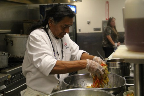 Chef Walter Whitewater tossing peppers in dressing (photo by Elizabeth Hoover)