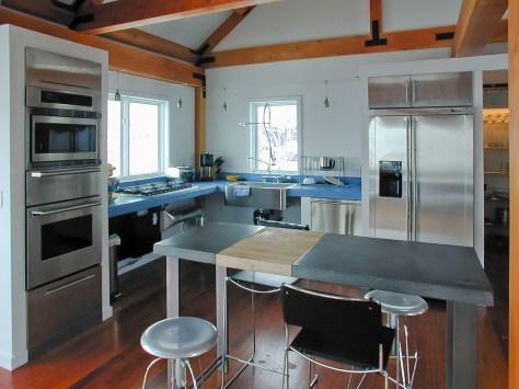 Kitchen showing blue concrete countertops