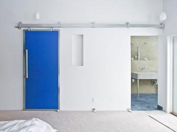 Rolling door closes closet or master bath
