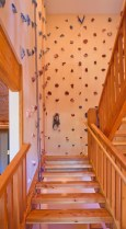 Stair case to upper level with climbing walls