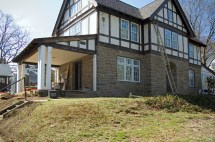 Tudor Style Home with Front Porch