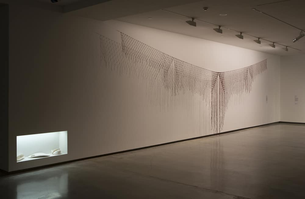 Lucy Simpson, Yilaalu  2015, installation view, Primavera 2015: Young Australian Artists, Museum of Contemporary Art Australia, paperclay, ironbark string, feathers, ochre, Image courtesy and © the artist, photo: Jessica Maurer