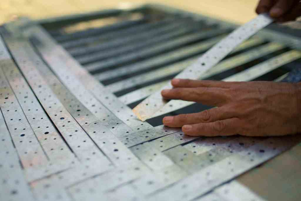 Work in progress, weaving with steel banding, Harry Sideris, carpenter & gallery installation technician