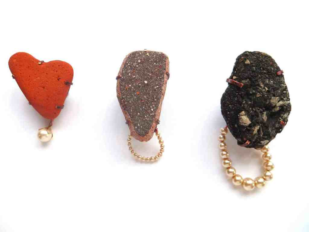 Lieta Marziali, Three Mourning Brooches (Lost, Gone Before, and Beach Road), 2013, beach-combed brick, paving and tarmac fragments, vintage faux pearls, copper, 6 x 4 x 2.2 cm (Lost), 7 x 3.5 x 2.5 cm (Gone Before), 8.5. x 5 x 3.5 cm (Beach Road), photo: Lieta Marziali
