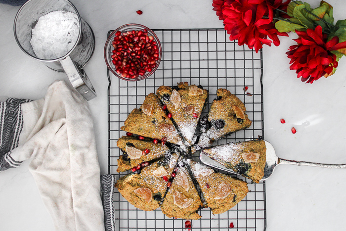 berry scones with powdered sugar on top