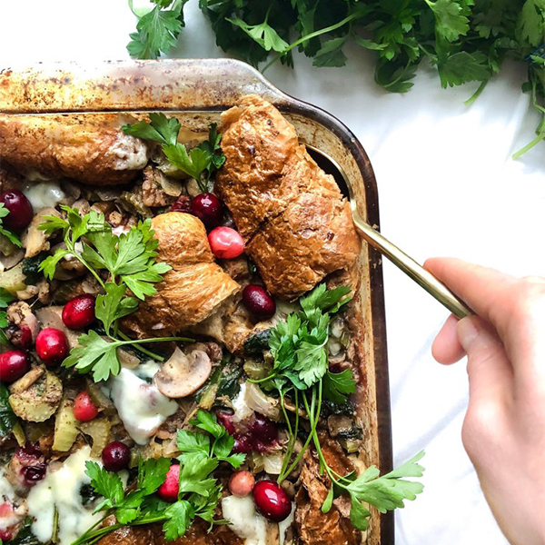 Take stuffing to the next level with croissants instead of bread! This delicious croissant stuffing side dish is sure to wow everyone at the table. Customizable and vegan! #vegan #stuffing #croissant #thanksgiving #side