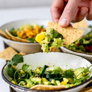 My three favorite recipes for homemade, healthy guacamole! Ready in minutes and perfect for feeding a crowd at a party, these simple ideas are full of flavor and easily customizable. Read on for Classic Guacamole, Spicy Mango Guacamole, and Elote-Inspired Guacamole!