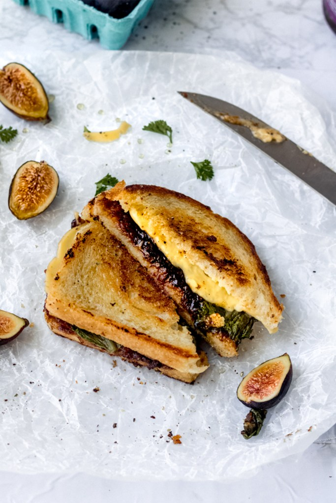 side view of a honey grilled cheese with figs