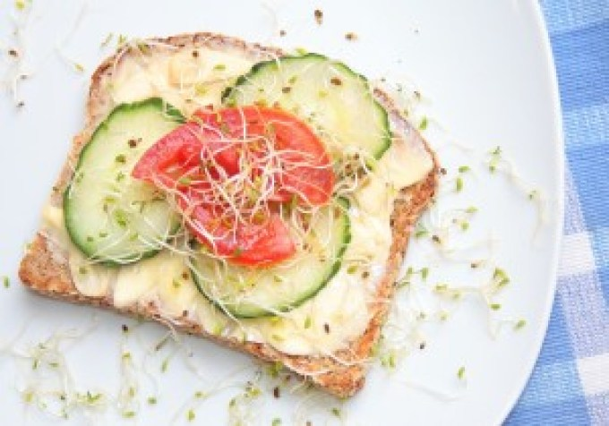 raw garlic on toast with tomato, cucumber & alfalfa sprouts