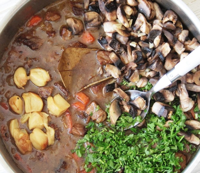 garlic beef stew adding ingredients