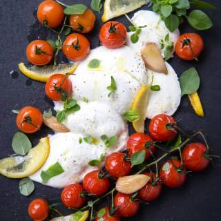 BAKED CHERRY TOMATO, MOZZARELLA AND BASIL SALAD WITH GARLIC CONFIT
